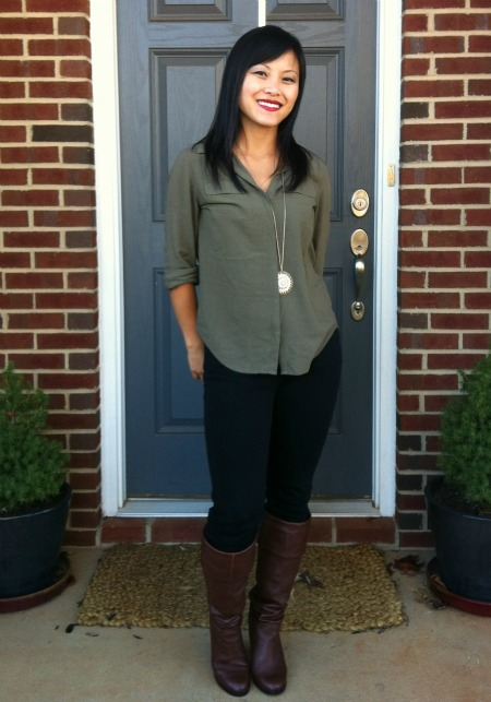 olive blouse with black pants and cognac boots